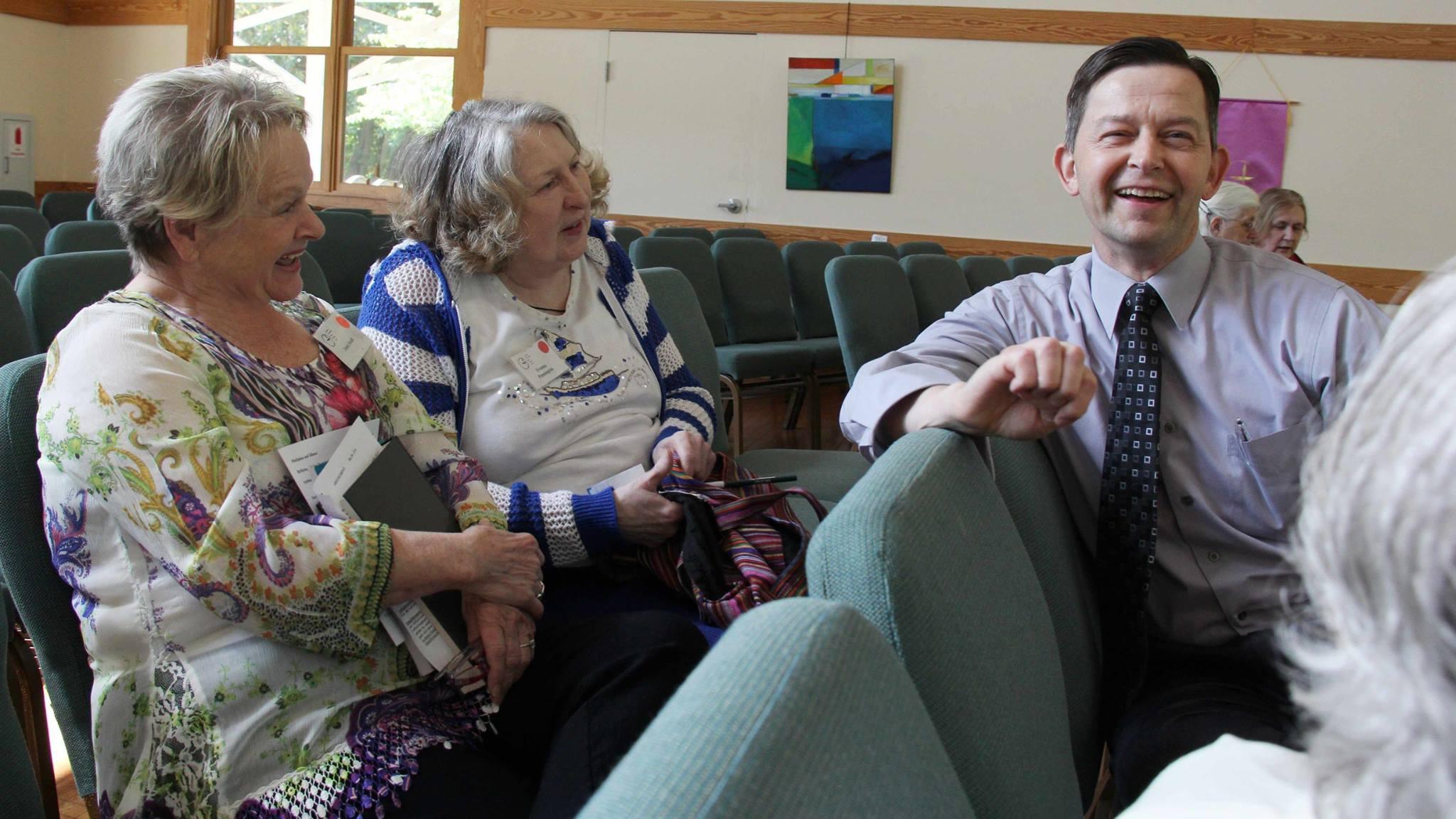 Dave Dunn converses with congregants